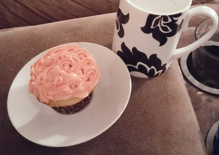 White cake mix cup cakes with strawberry frosting.