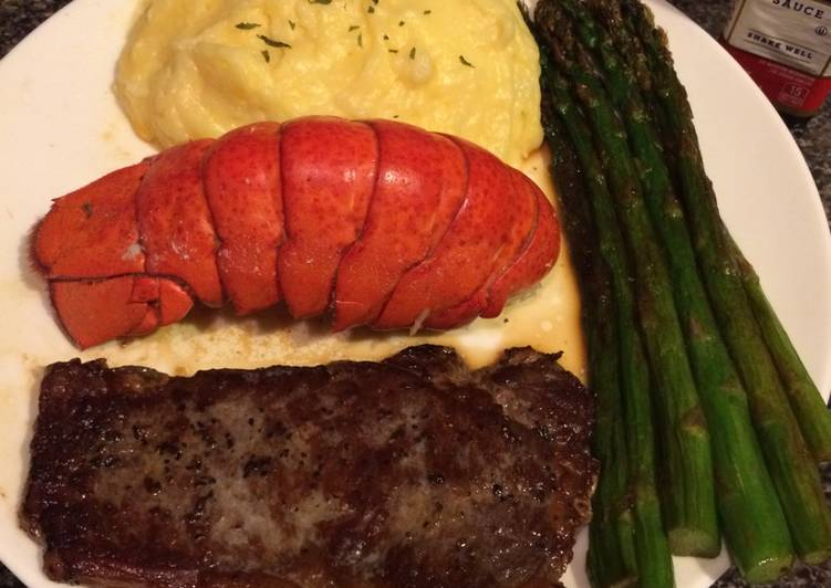 Thin cut New York strip with lobster and asparagus