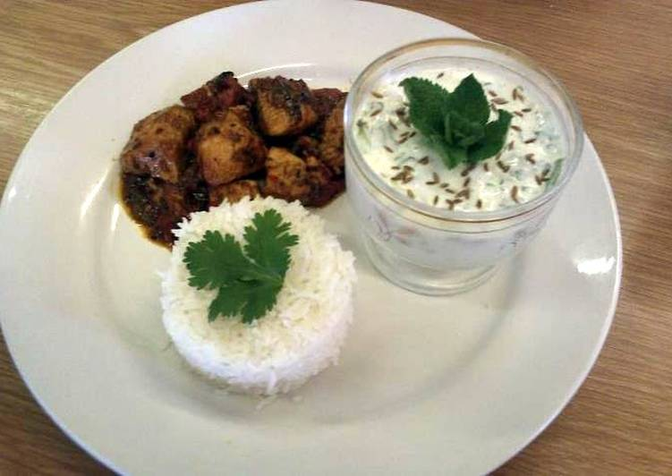 Achar (eastern pickle) Chicken curry served with rice and a mint and cucumber raita.