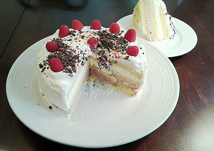 Butter Cake filled with Rasberry and Lemon Whipped Cream, with a Vanilla Whipped Cream Topping