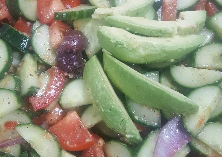 Greek tomato and cucumber salad with avocados