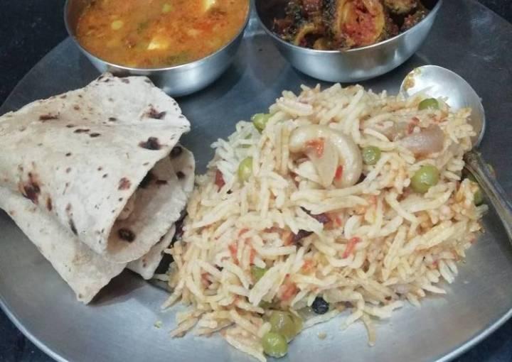 Pea curry Pulao Karela and chapati
