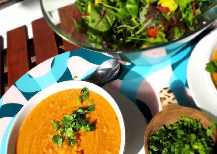 Spicy red lentil soup with onion and coriander