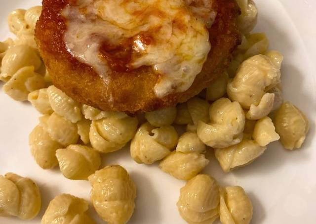 Parmesan chicken over macaroni and cheese