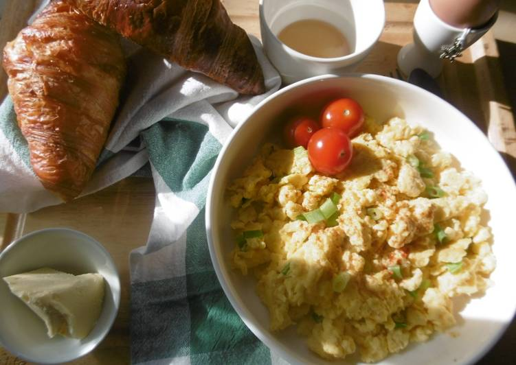 A simple morning breakfast with scrambled eggs & fresh scallions