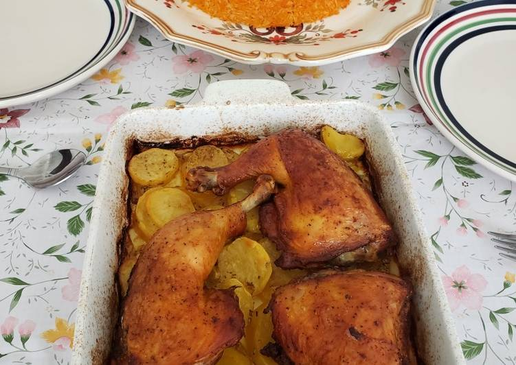 Red rice with chicken legs and potatoes