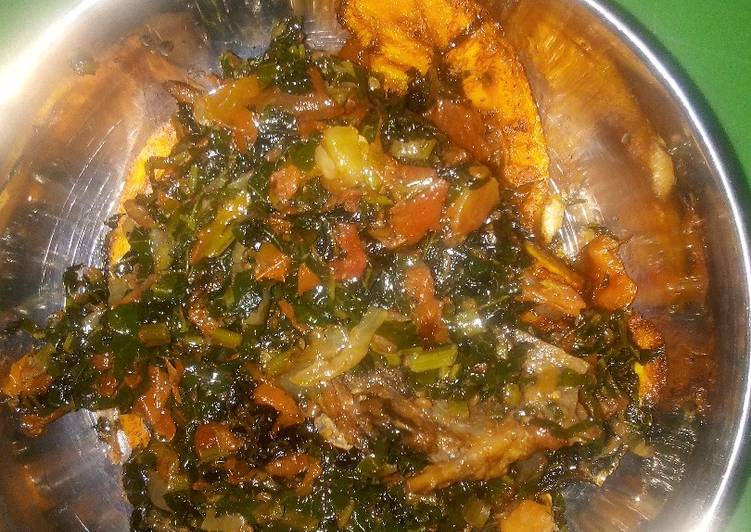 Fried plantain and water leaf stew