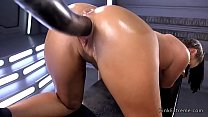 Hot brunette babe Roxy Raye strips off her blue thong and then gets huge dildo fucking machine in the ass