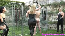 Femdom take turn whipping submissive outdoor