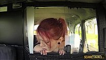 Unusual redhead babe rides a gigantic dick in the taxi
