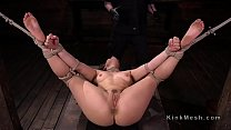 Gagged brunette slave Kimber Woods hogtied in chair drooling over gag ball during torment