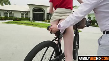 Dads teach daughters how to ride bicycles