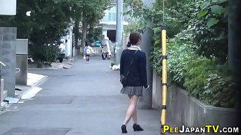 Asian babe pees publicly