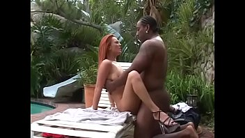 Black meat stuffs a pretty redhead Donna Marie on pool chair outdoor