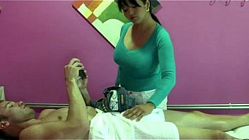 Busty real masseuse tugs cock before sucking