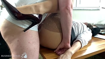 business woman in stockings and highheels with red lipstick wants to get pregnant by her boss