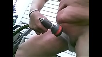 pig outdoor with hose on cunt