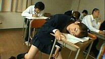 Japanese teen in schoolgirl uniform sleeping in classroom