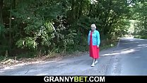 Hitchhiking old blonde granny