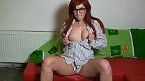 Horny redhead toying on the couch