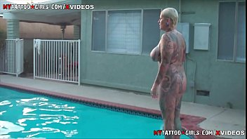 Bokep XXX Heavy Tattooed Milf hanging out by the pool