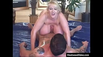 Hooter Nation #2 - Kayla Kleevage, Buster Good - Mom with gigantic boobs pours oil all over her big tits while a horny stepson fucks her