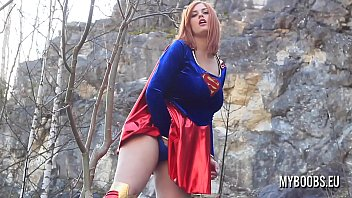 Busty SuperWoman Cosplay outdoor playing and striptease then play with her huge natural boobs and running
