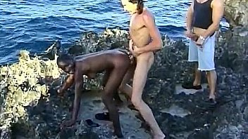 Black woman fucked by two white guys at seaside