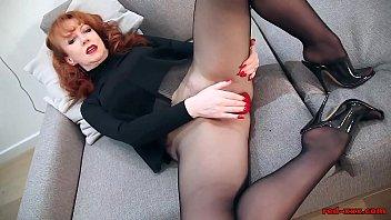 Naughty mature redhead Red XXX masturbates in stockings
