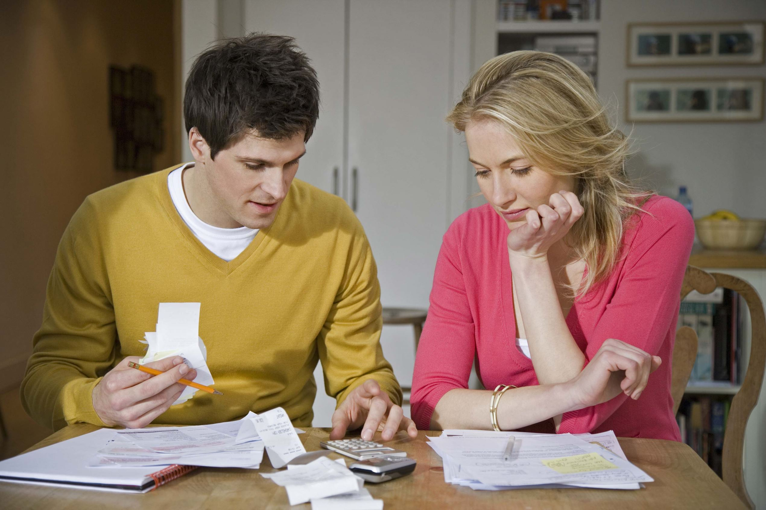A young couple looks over their expenses.