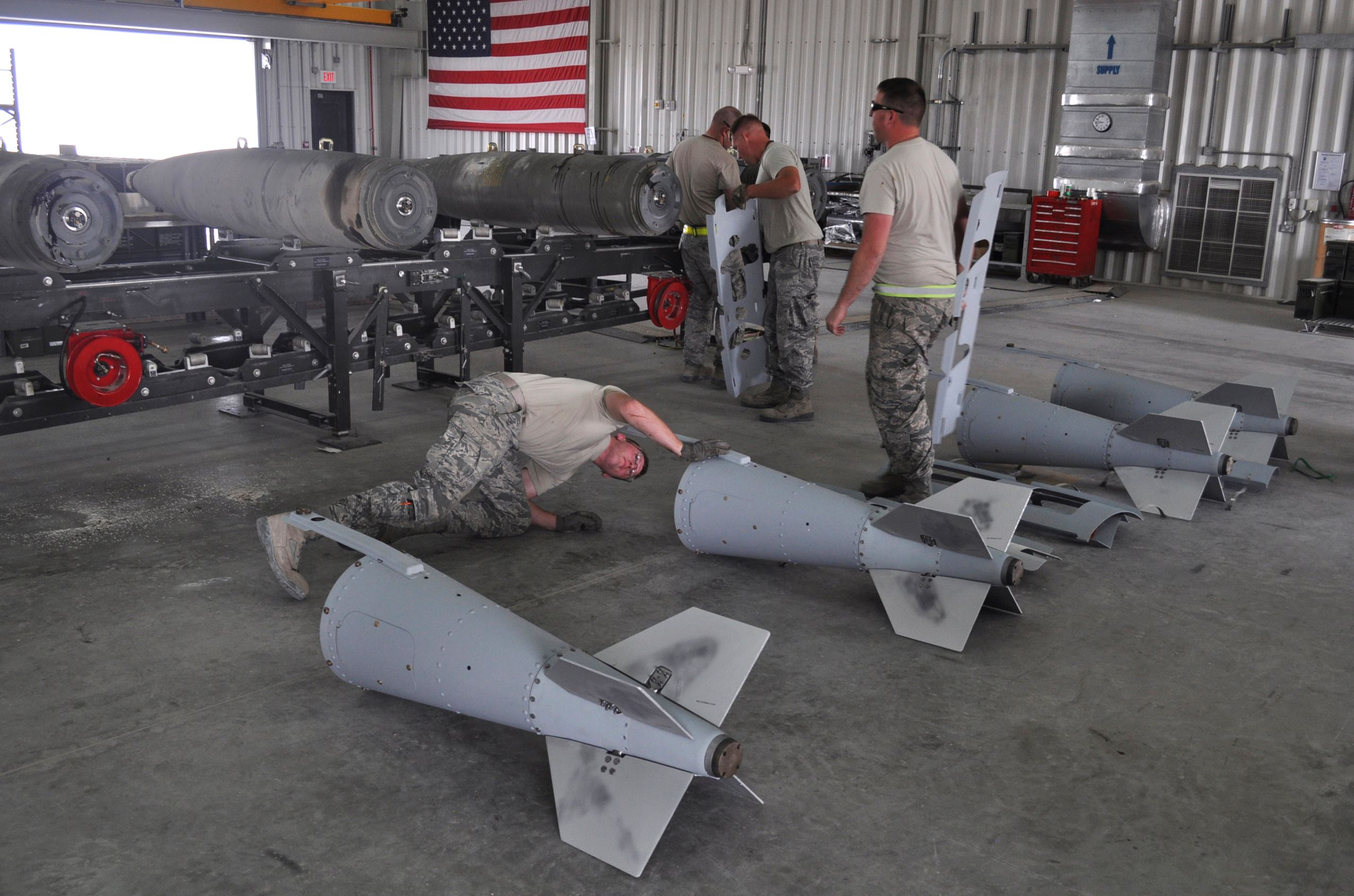 Members of a U.S. Air Force munitions team assemble guided bombs to support the 379th Air Expeditionary Wing at the al-Udeid Air Base in Qatar. The base is the regional nerve center for the air war against the militants who have taken over nearly a third of Iraq and Syria. That makes it the main hub for coordinating warplanes from the U.S. and 11 other nations in the coalition carrying out bombing raids.