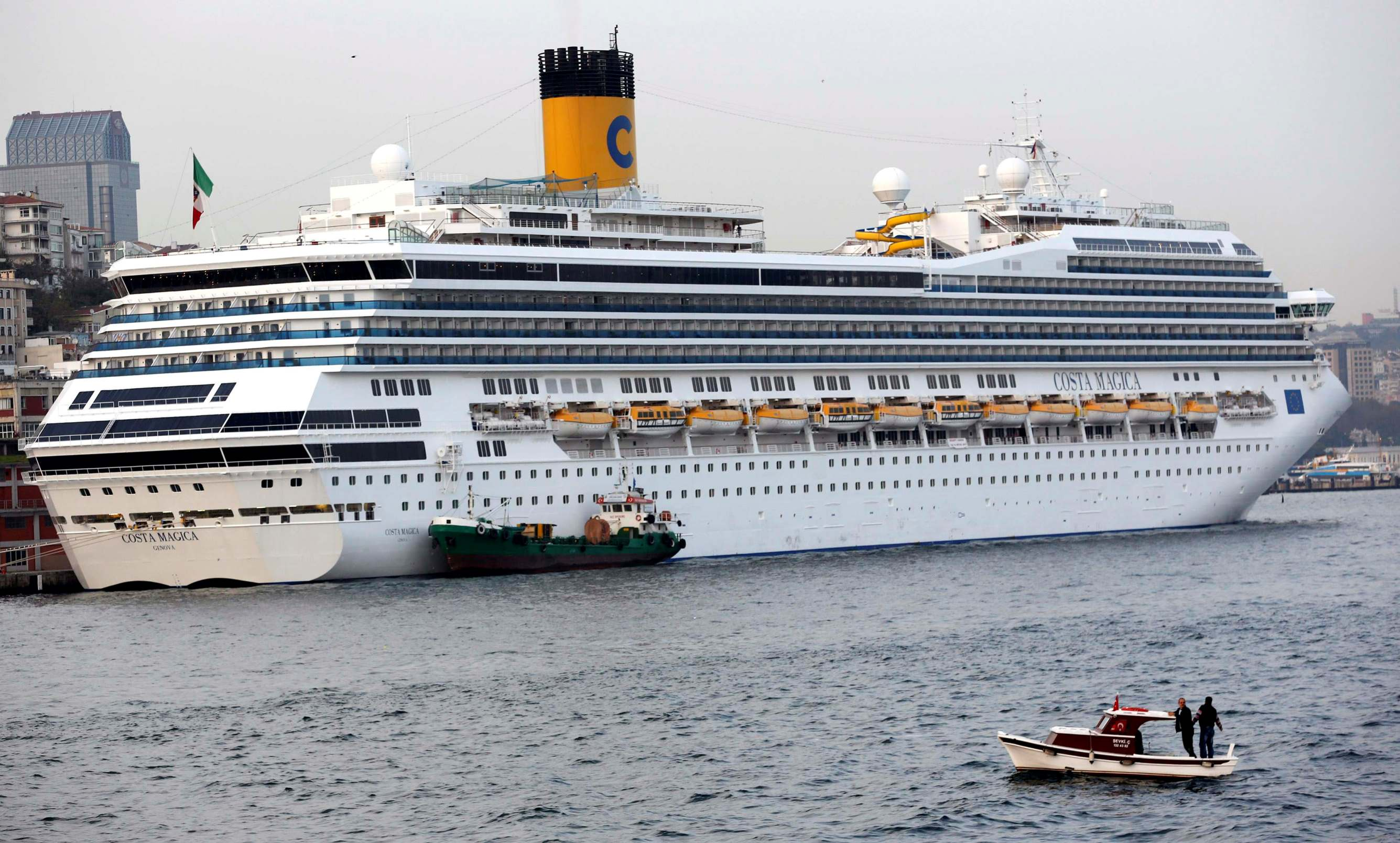 Italian-flagged cruise ship Costa Magica sets sail through the Bosporus in Istanbul November 7, 2014. An attempted murder investigation has been launched in northern Italy after a woman thought to have tried suicide by jumping to her death off a Costa cruise ship in Norway awoke from a long coma and said she had not tried to kill herself.