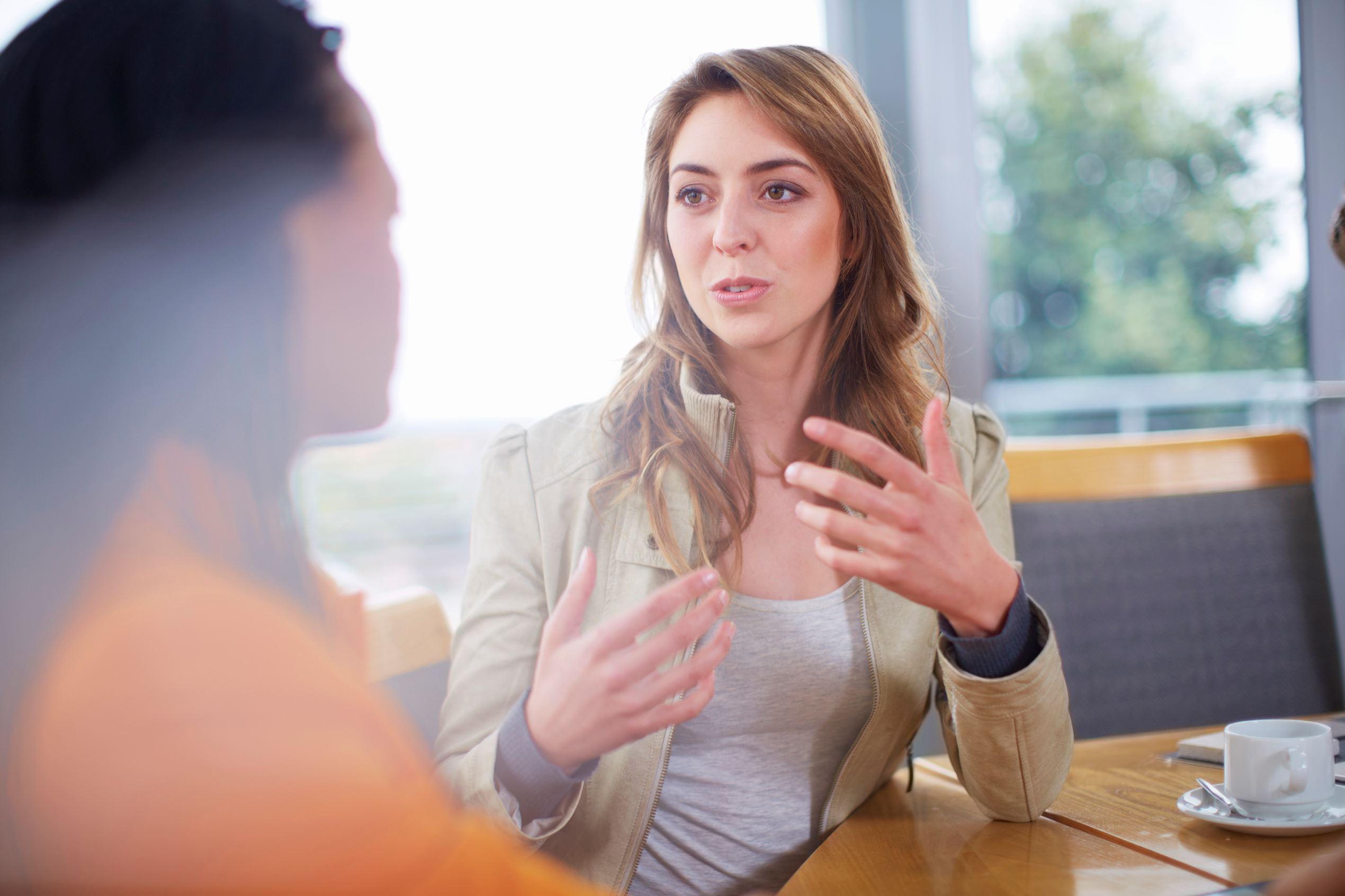 Portrait of businesswomen talking.