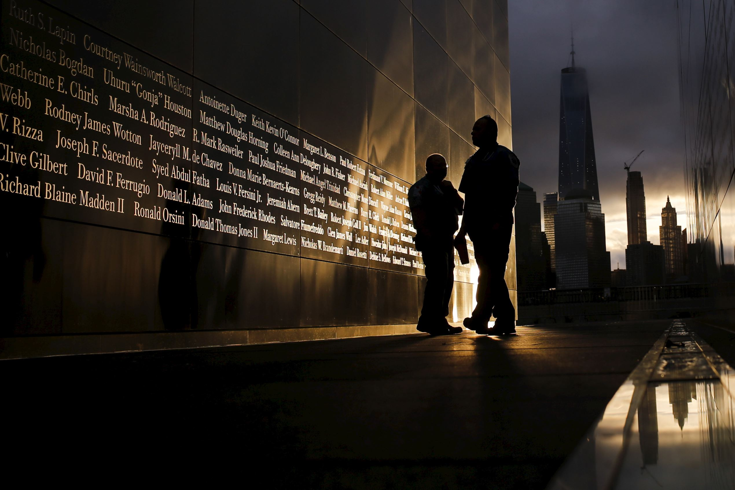 People read victims' names at the 9/11 Empty Sky memorial at sunrise in Liberty State Park in Jersey City, N.J., on September 11, 2015.