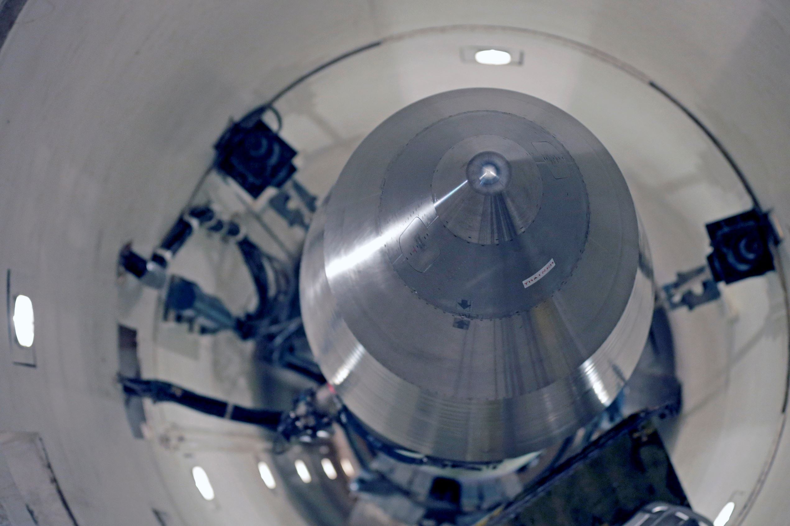 This photo taken June 25, 2014, shows an inert Minuteman 3 missile in a training launch tube at Minot Air Force Base, N.D. The base is tasked with maintaining 150 of the nuclear-tipped missiles spread out across the North Dakota countryside and keeping them ready to launch at a moment's notice as part of the US's nuclear defense strategy.