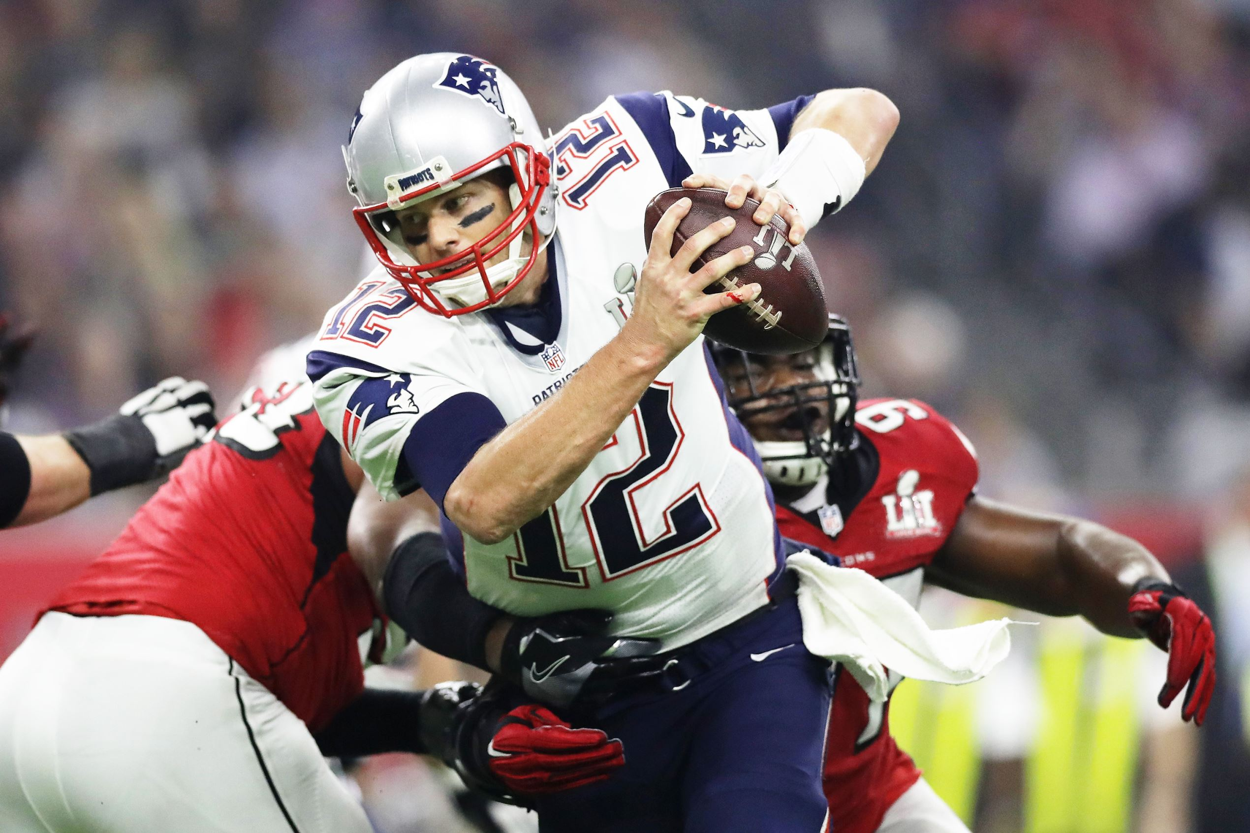 Slide 3 of 29: Tom Brady #12 of the New England Patriots is sacked by Grady Jarrett #97 of the Atlanta Falcons in the fourth quarter during Super Bowl 51 at NRG Stadium on Feb. 5, in Houston, Texas.