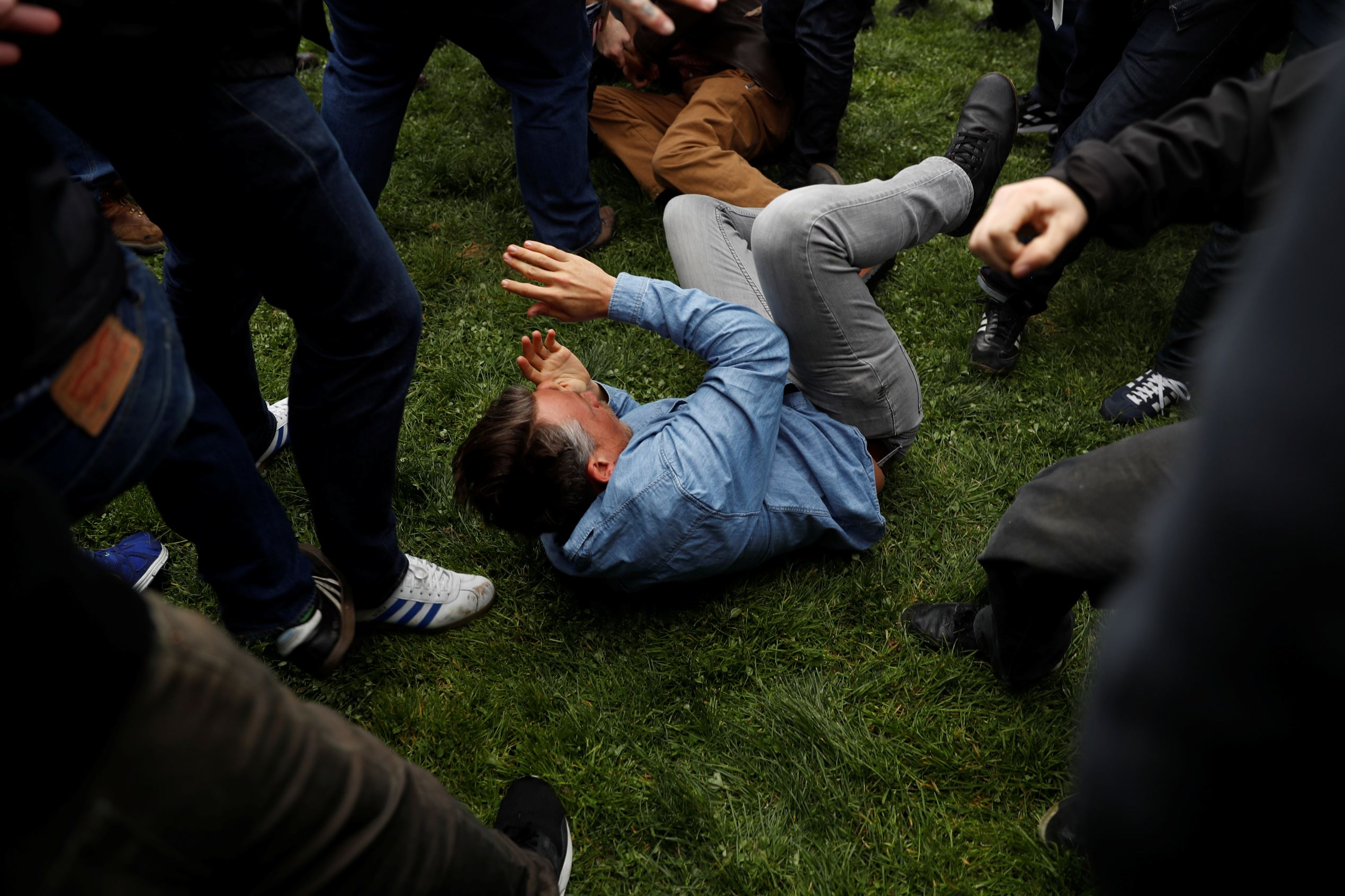 "A demonstrator falls to the ground as a fight breaks out during a ""People 4 Trump"" rally and counter-demonstrations in Berkeley, California March 4, 2017."