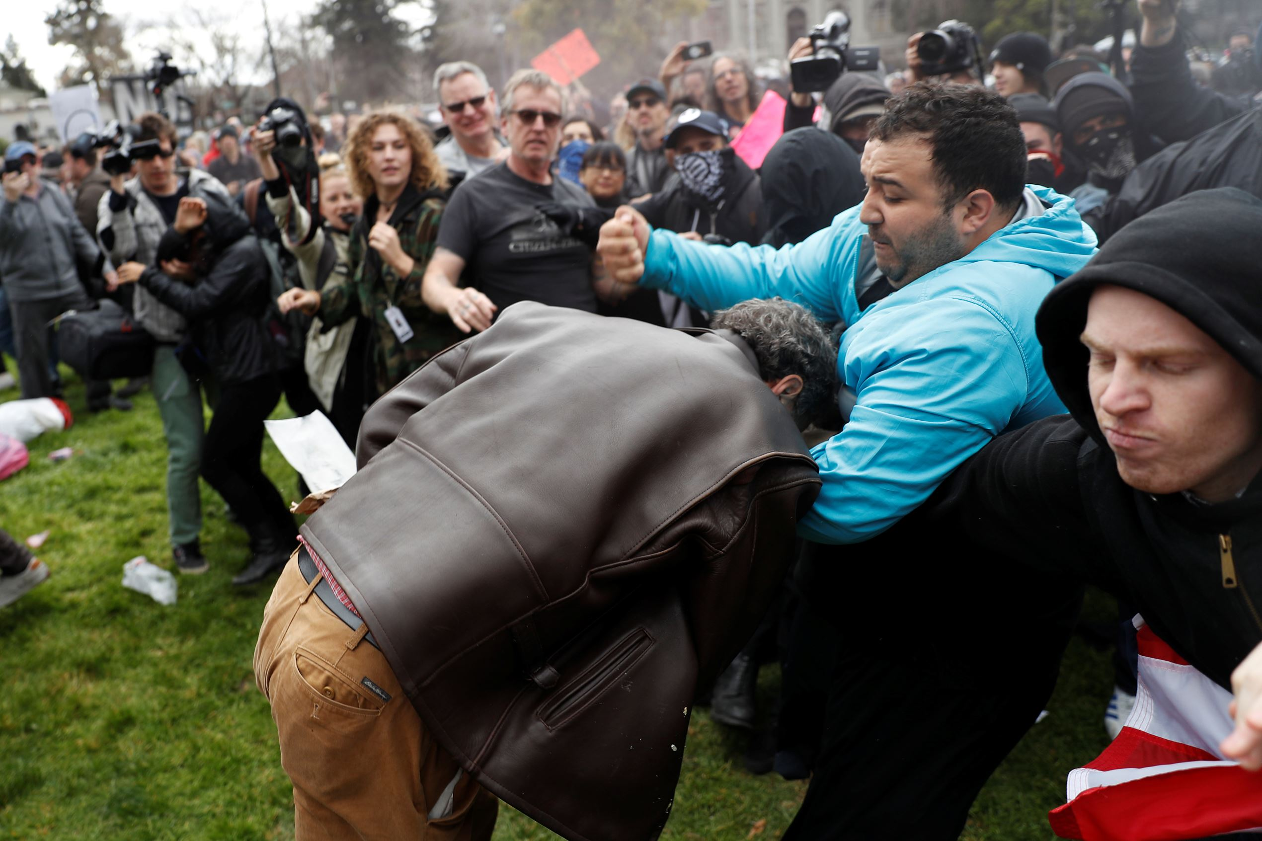 "A demonstrator in support of U.S. President Donald Trump (L) scuffles with a counter-protester during a ""People 4 Trump"" rally in Berkeley, California March 4, 2017."