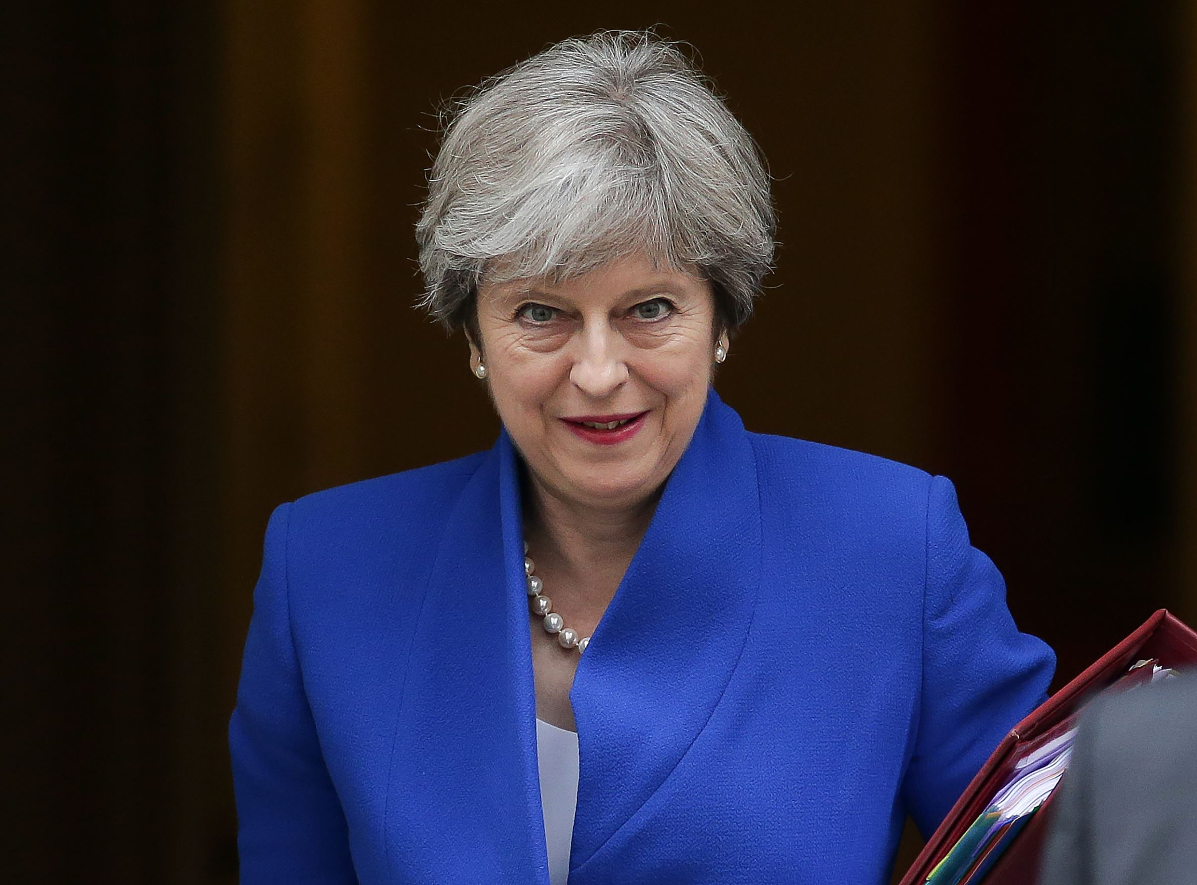Britain's Prime Minister Theresa May leaves 10 Downing Street in central London on July 19, 2017, on her way to the Houses of Parliament to speak at Prime Minister's Questions