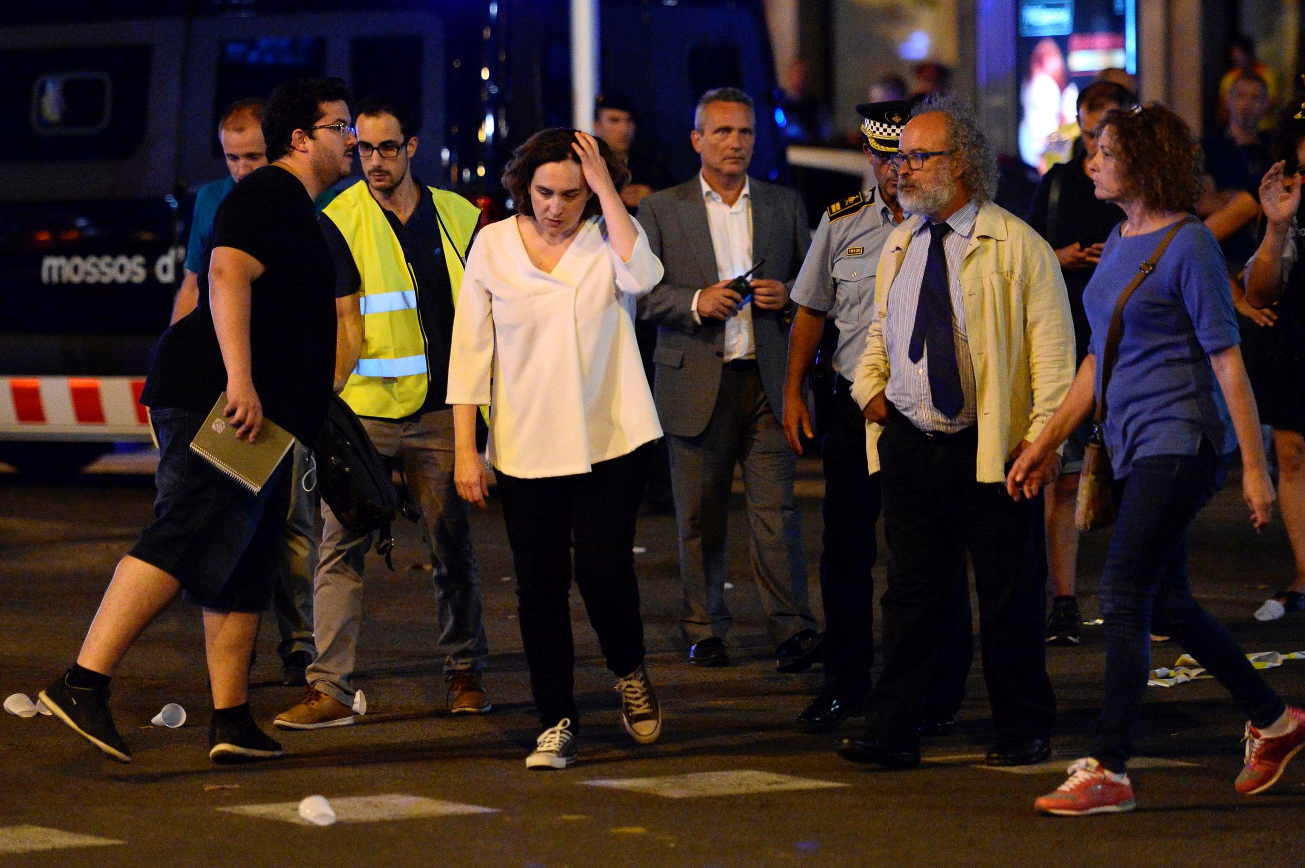 """Slide 4 of 25: Barcelona's Mayor Ada Colau (3rdL) and officials arrive on the Rambla boulevard after a van ploughed into the crowd, killing at least 13 people and injuring around 100 others on the Rambla in Barcelona on August 17, 2017. A driver deliberately rammed a van into a crowd on Barcelona's most popular street on August 17, 2017 killing at least 13 people before fleeing to a nearby bar, police said.  Officers in Spain's second-largest city said the ramming on Las Ramblas was a """"terrorist attack"""". The driver of a van that mowed into a packed street in Barcelona is still on the run, Spanish police said. / AFP PHOTO / Josep LAGO        (Photo credit should read JOSEP LAGO/AFP/Getty Images)"""