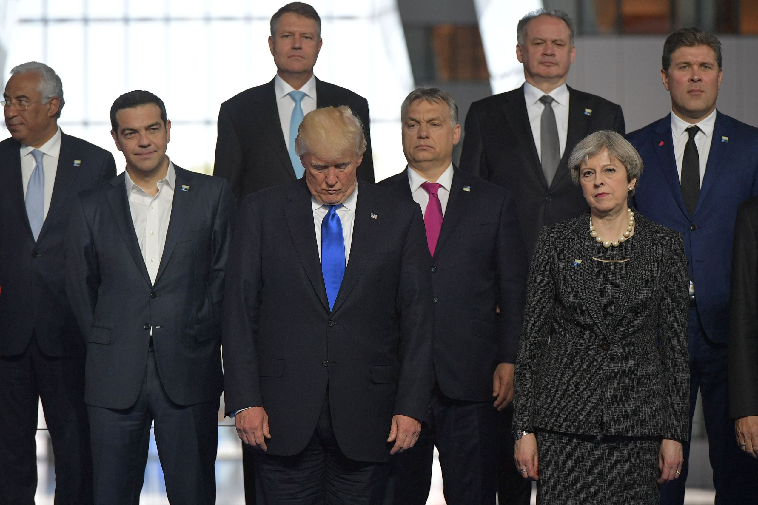 US President Donald Trump (front row C) reacts as he stands by (front row from L) Portuguese Prime Minister Antonio Costa, Greek Prime Minister Alexis Tsipras, Hungary's Prime Minister Viktor Orban, Britain's Prime Minister Theresa May, (back row from L Romanian President Klaus Werner Iohannis, Slovakia's President Andrej Kiska and Iceland's Prime Minister Bjarni Benediktsson, during a family picture during the NATO (North Atlantic Treaty Organization) summit at the NATO headquarters, in Brussels, on May 25, 2017.