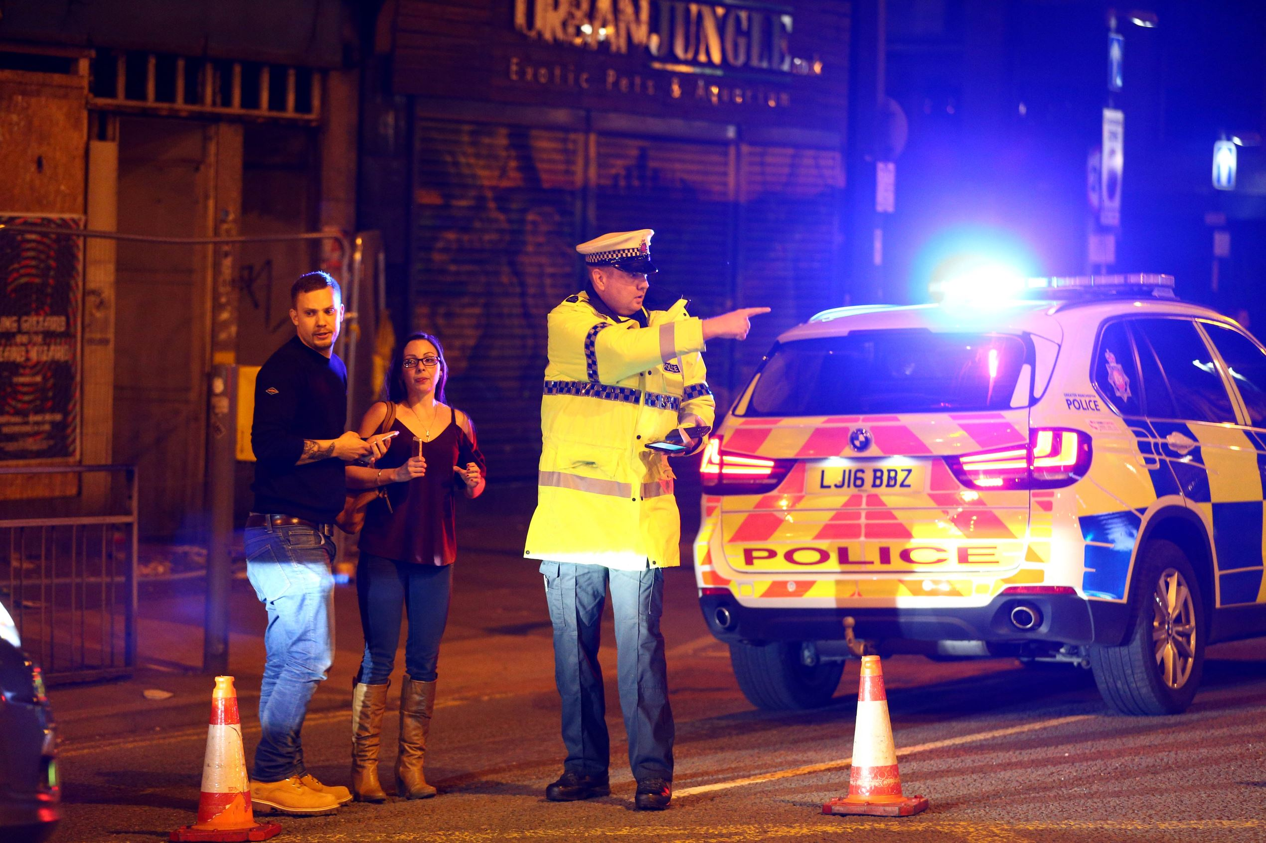 Police stand by a cordoned off street close to the Manchester Arena on May 22, 2017 in Manchester, England. There have been reports of explosions at Manchester Arena where Ariana Grande had performed this evening. Greater Manchester Police have have confirmed there are fatalities and warned people to stay away from the area.