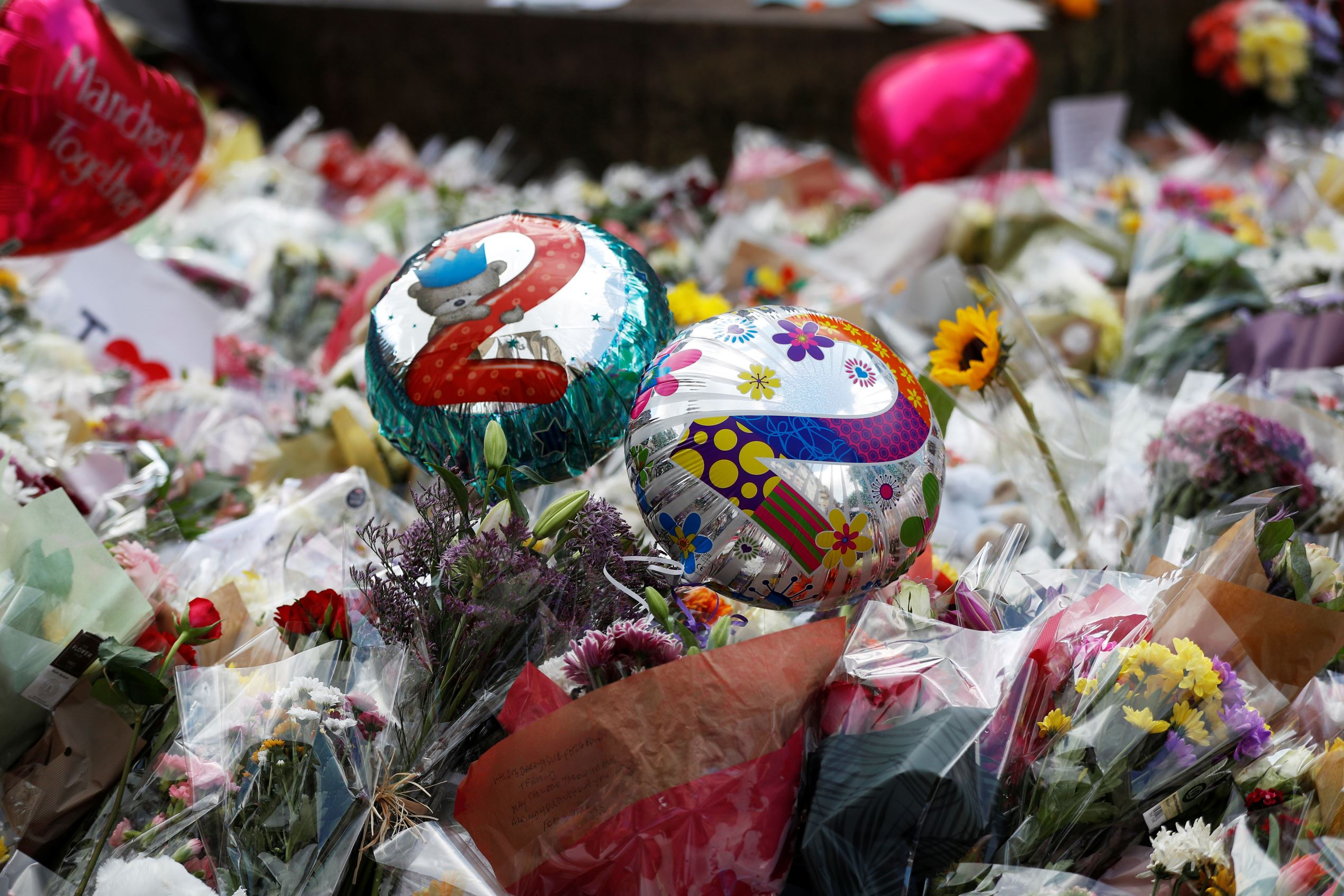Balloons and floral tributes for the victims of the attack on the Manchester Arena are seen in St Ann's square in Manchester, Britain, May 24, 2017.