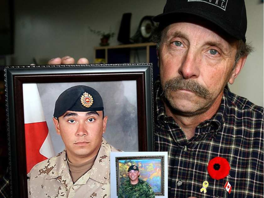 Murray Marshall, father of Sapper Steven Marshall, holds some pictures of his son killed in Afghanistan in 2009. (File photo)