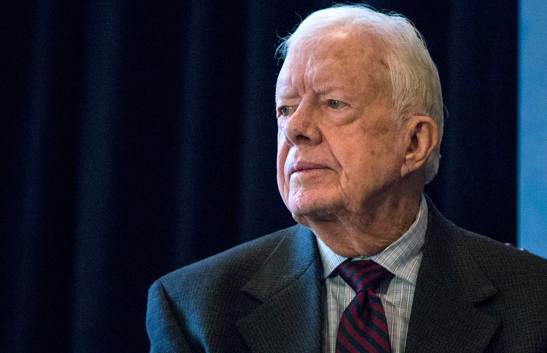 "Former U.S. President Jimmy Carter speaks at a press conference to open a new exhibit at the American Museum of Natural History on January 12, 2015 in New York City. The exhibit, titled ""Countdown to Zero: Defeating Disease,"" was developed in collaboration with The Carter Center."