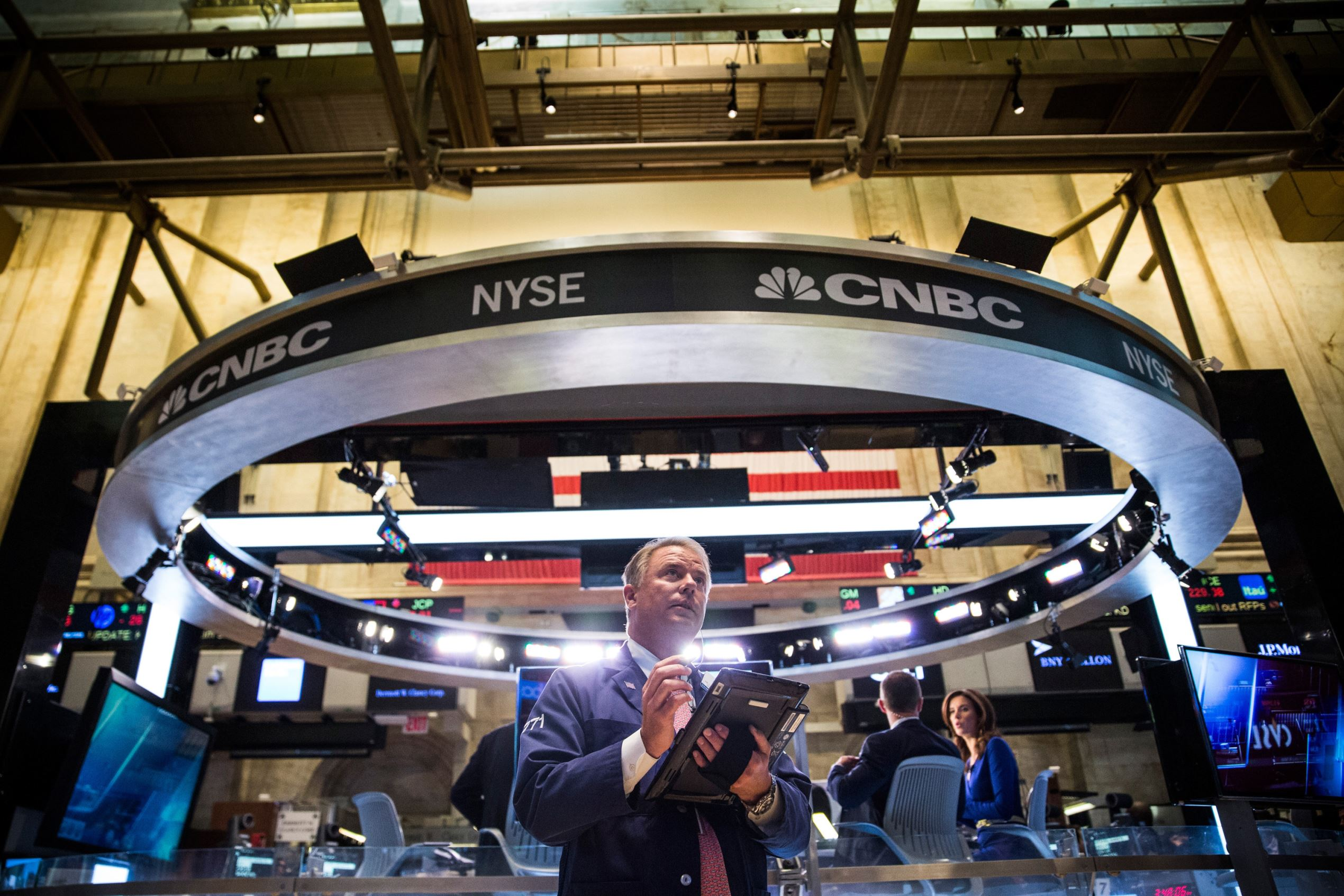 A trader works on the floor of the New York Stock Exchange during the afternoon of August 26, 2015 in New York City.