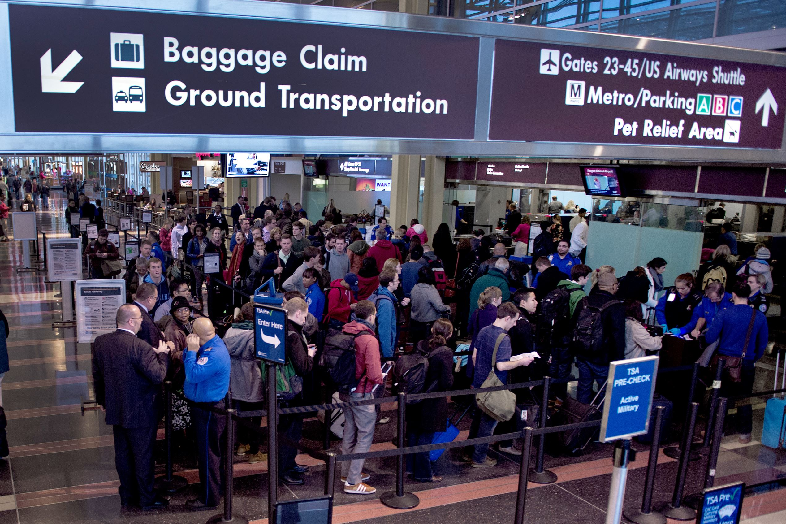 File photo of travelers at Ronal Reagan National Airport in Washington, DC.