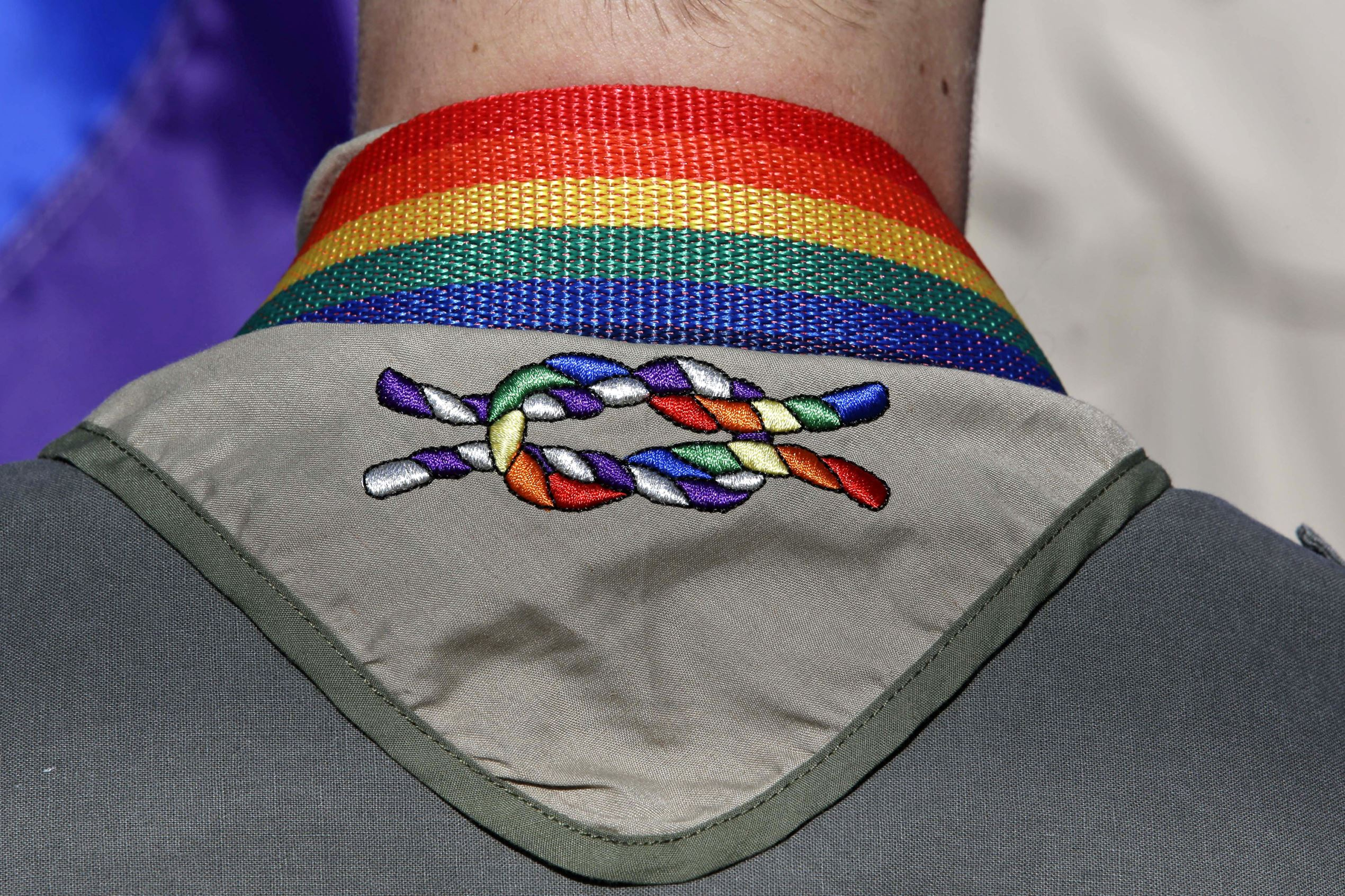 A Boy Scout wears his kerchief embroidered with a rainbow knot during Salt Lake City's annual gay pride parade. The Mormon Church, the nation's largest sponsor of Boy Scout units, is keeping its longtime affiliation with the organization despite its decision to allow gay troop leaders. Church leaders decided to stay with the Boy Scouts after getting assurances they can appoint troop leaders according to their own religious and moral values, The Church of Jesus Christ of Latter-day Saints said in a news release Wednesday, Aug. 26, 2015.