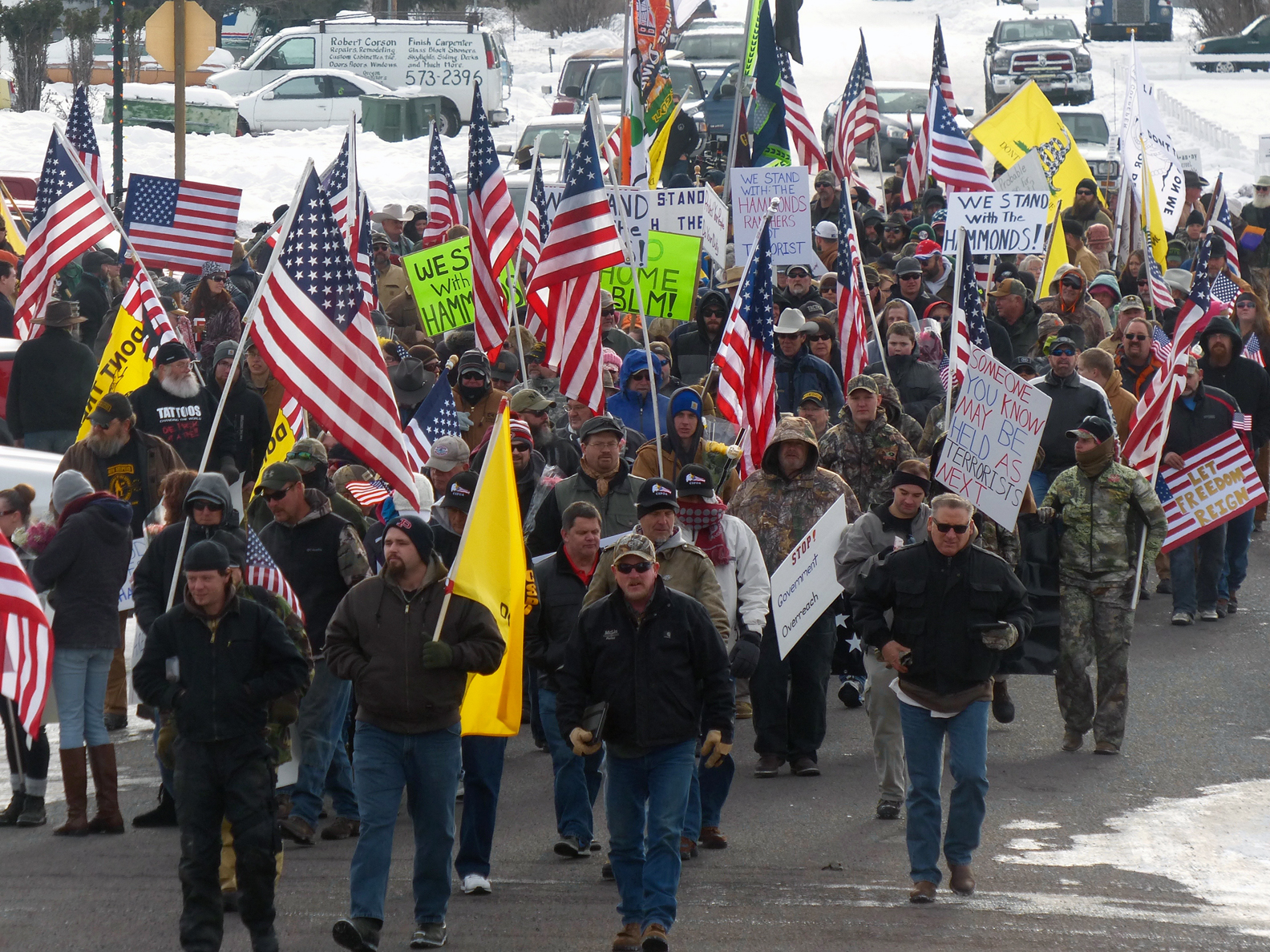 Protesters march on Court Avenue in support of an Oregon ranching family facing jail time for arson in Burns, Ore., Saturday, Jan. 2, 2016.