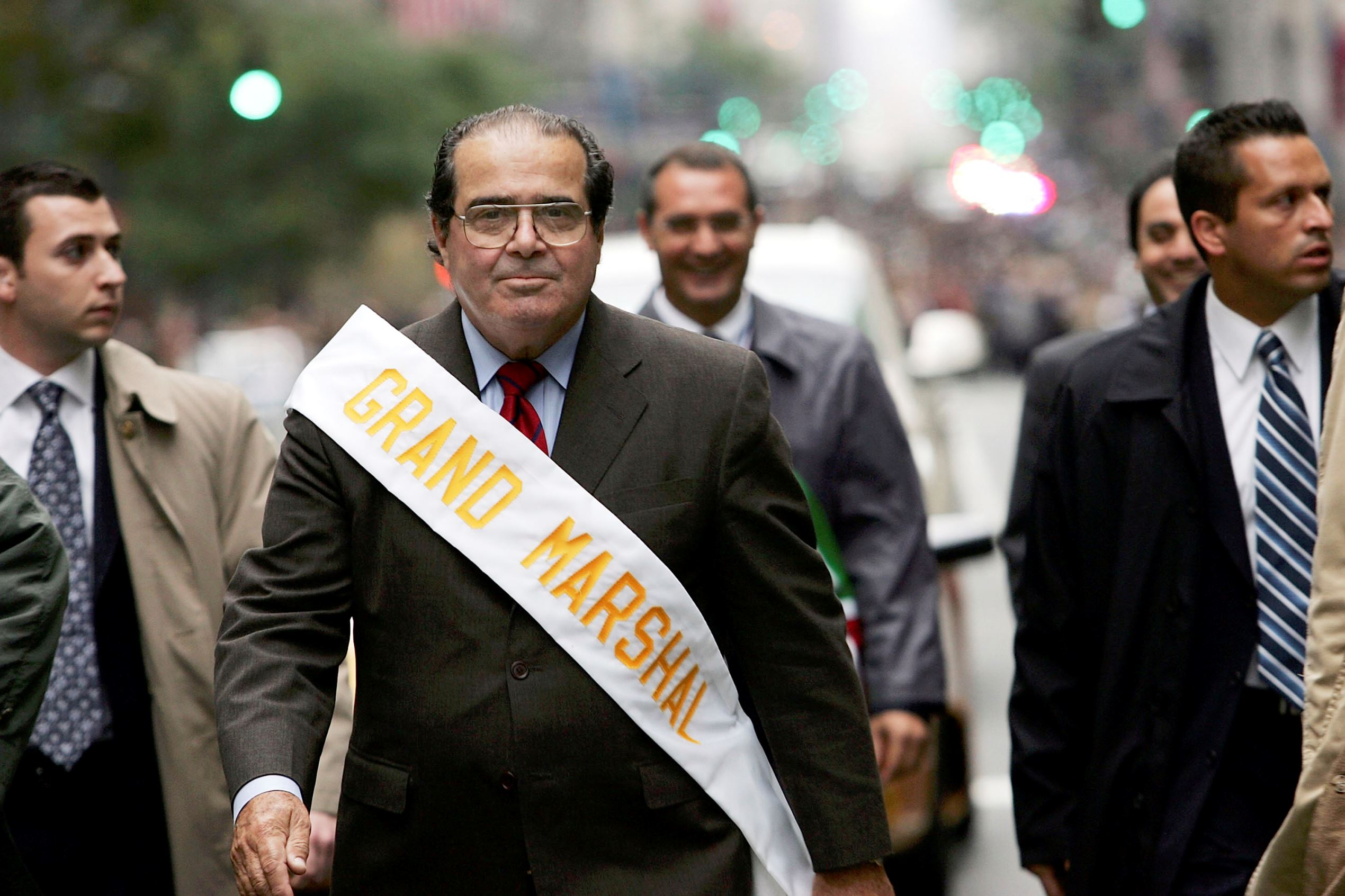 Surrounded by security, Supreme Court Justice Antonin Scalia walks October 10, 2005 in the annual Columbus Day Parade in New York City. This is the 61st Columbus Parade which celebrates both the explorer and Italian cultural influence on America.